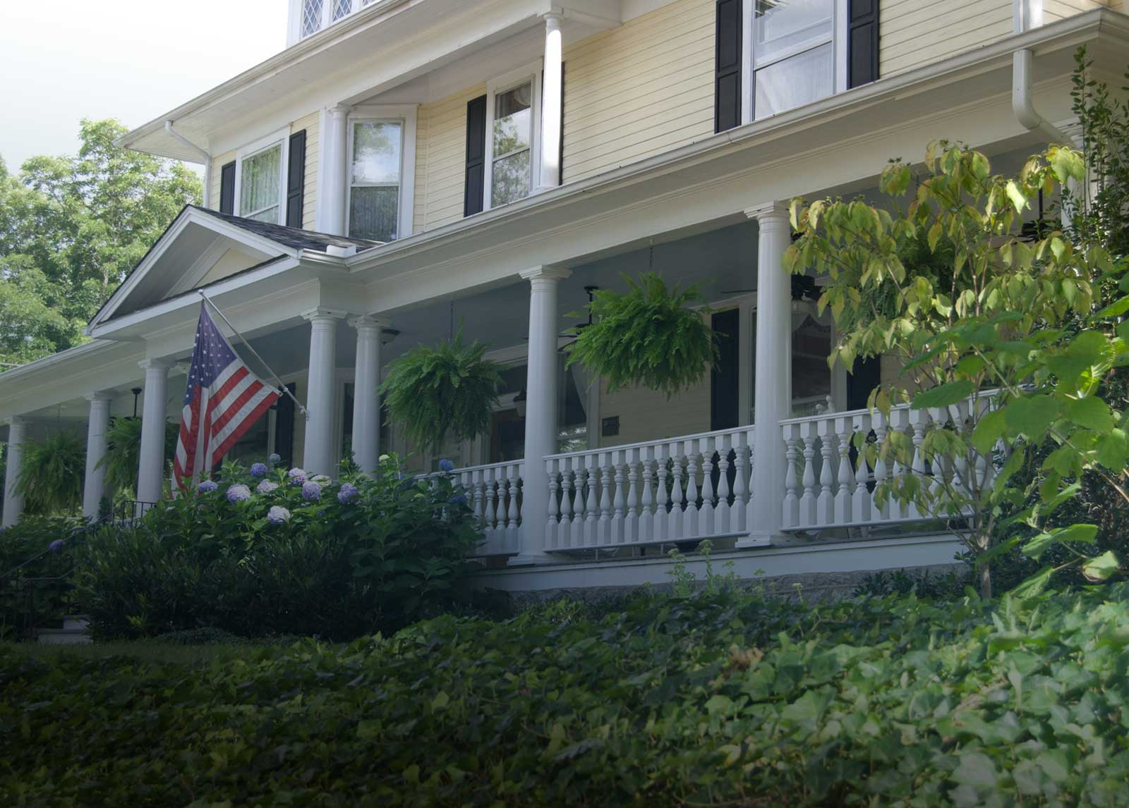 front porch of Elizabeth Leigh Inn bed and breakfast in Hendersonville NC